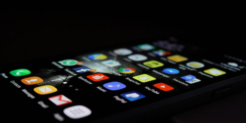 Image of iPhone with Social Media Icons with Black Background